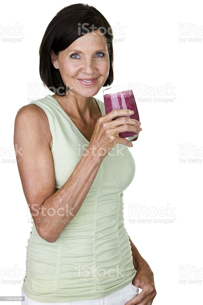 Mature woman drinking a fruit smoothie royalty-free stock photo