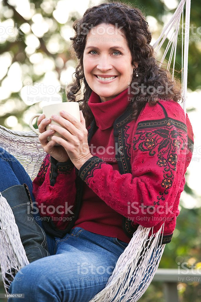 Mature woman drinking coffee royalty-free stock photo