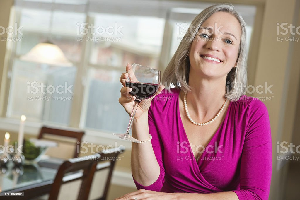 Mature woman drinking red wine while on a date royalty-free stock photo
