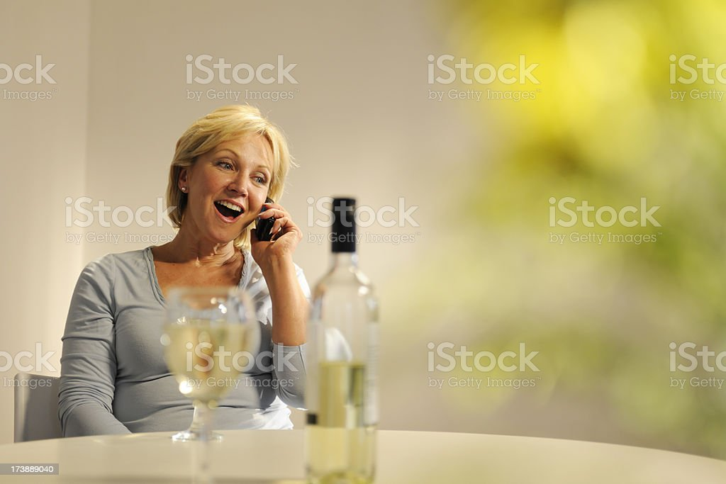 Mature Woman Drinking Wine royalty-free stock photo