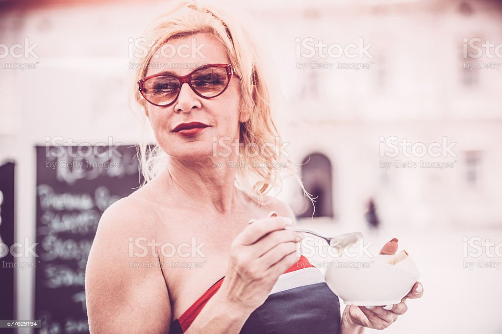 Mature Woman Eating Ice Cream stock photo