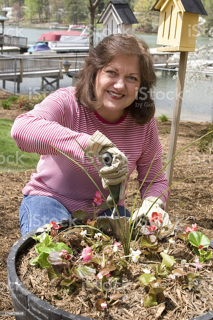 Mature woman enjoying time in the garden royalty-free stock photo