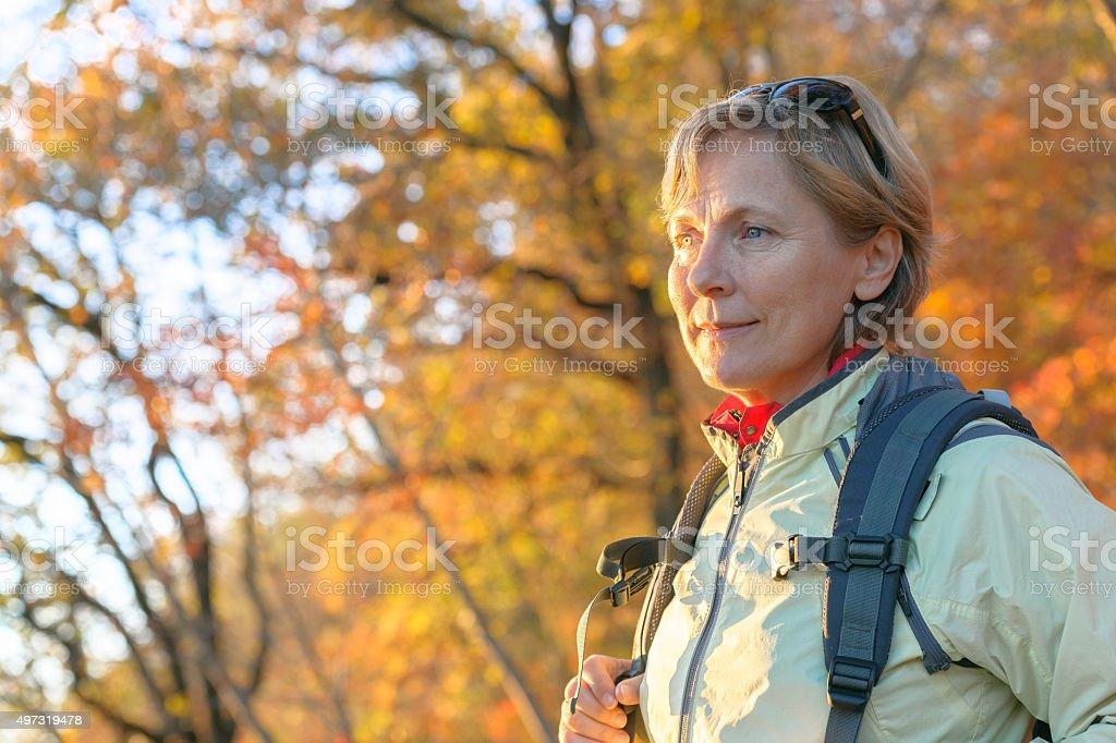 Mature  woman enjoys autumn colors,portrait, Slovenia,Europe stock photo