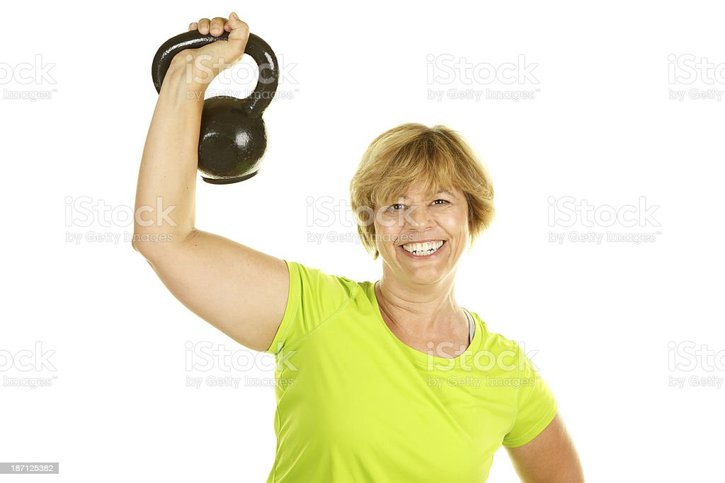 Mature Woman Exercising Lifting Kettlebell Weight on White Background royalty-free stock photo
