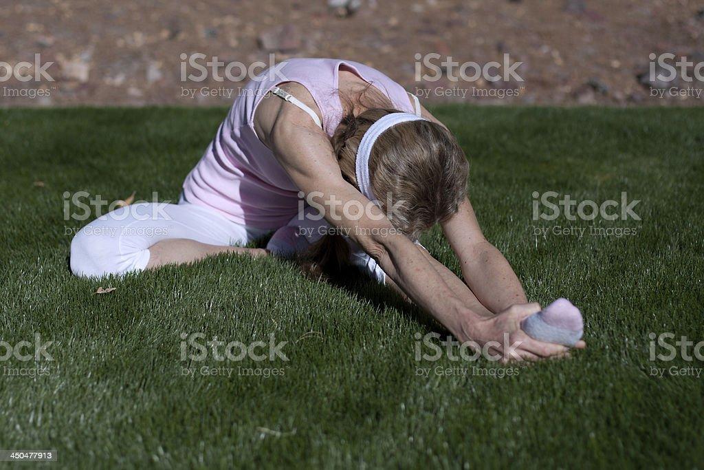 mature woman exercising stock photo