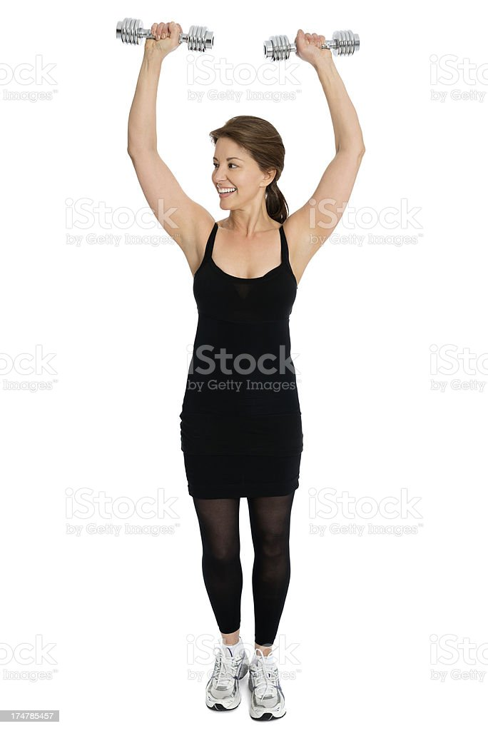 Mature Woman Exercising With Dumbbells royalty-free stock photo