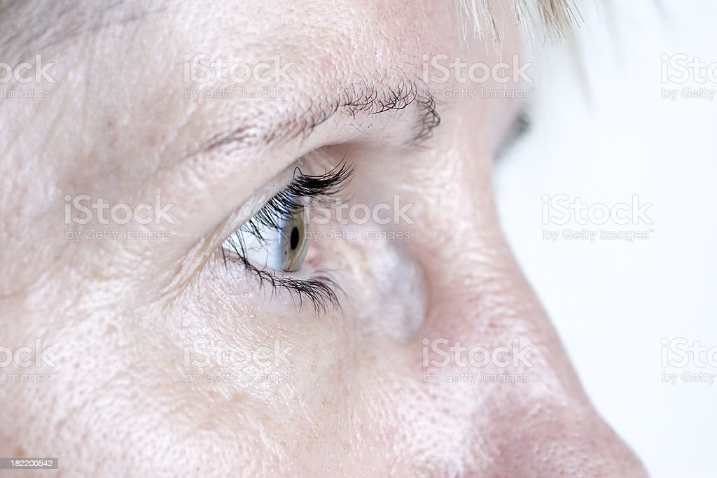 Mature woman eye closeup in profile stock photo