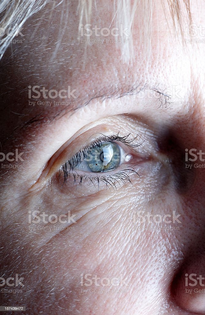 Mature woman eye closeup stock photo