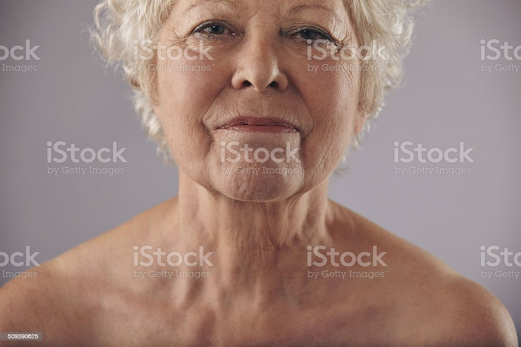 Mature woman face with wrinkled skin stock photo