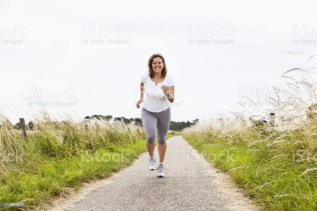 mature woman fitness sport outdoors royalty-free stock photo
