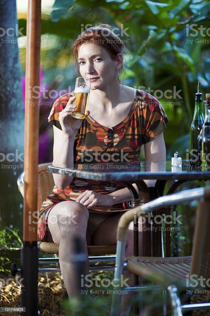 mature woman flirting in a bar patio stock photo
