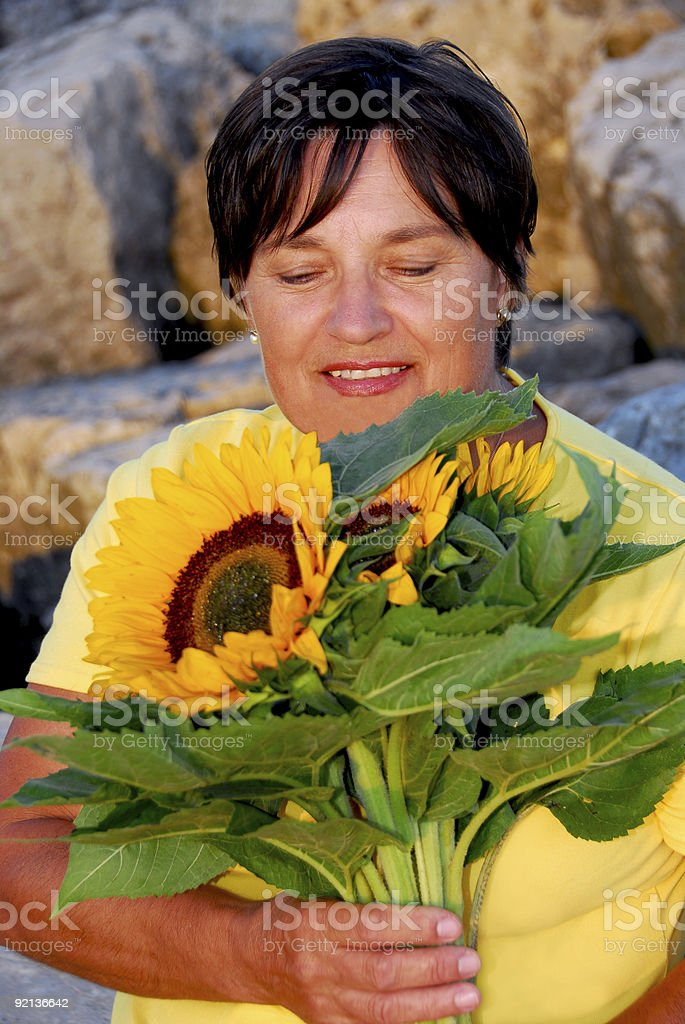 Mature woman flowers royalty-free stock photo