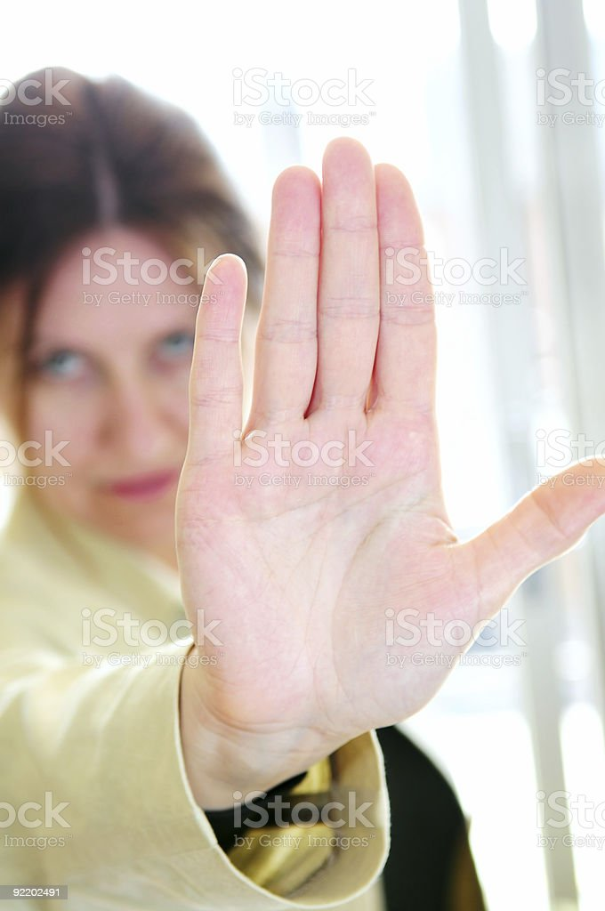 Mature woman gesturing stop royalty-free stock photo