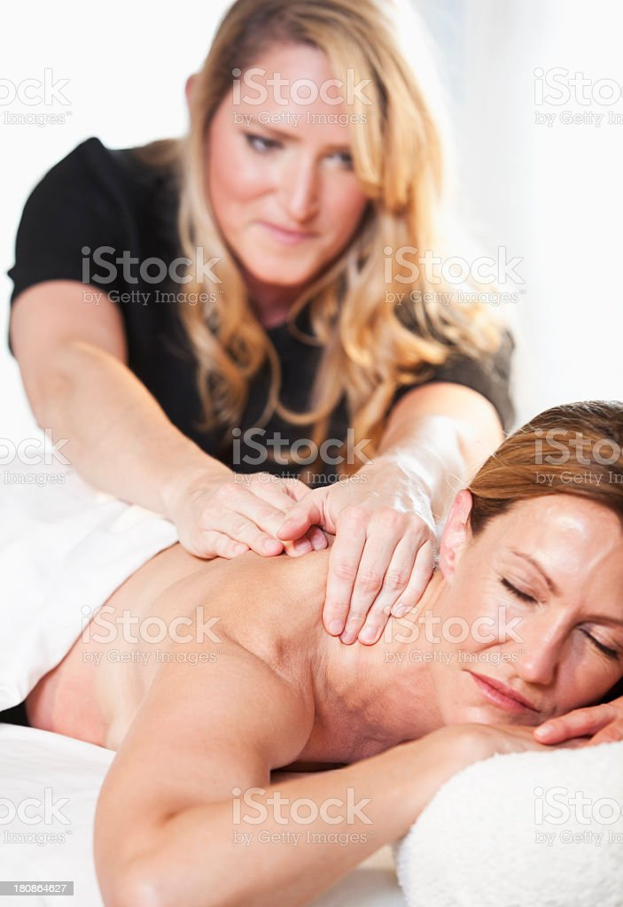 Mature woman getting massage royalty-free stock photo