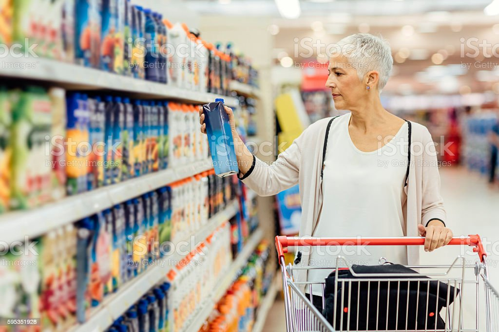 Mature Woman Groceries Shopping. stock photo