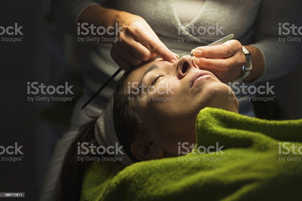 Mature woman having cosmetic treatment royalty-free stock photo