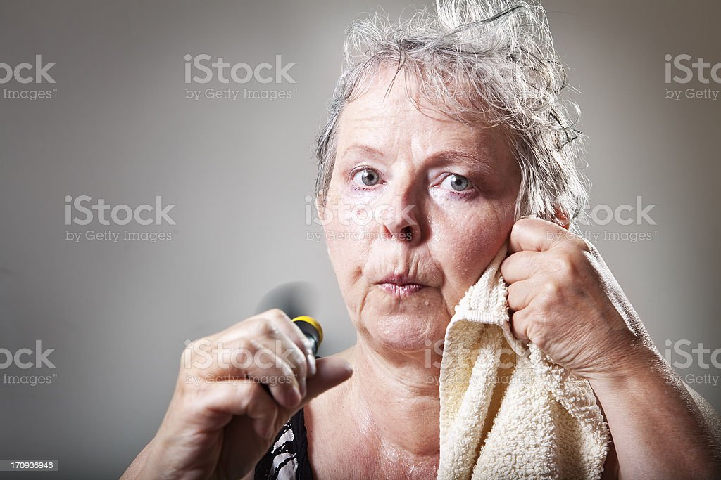 mature woman having hot flash stock photo