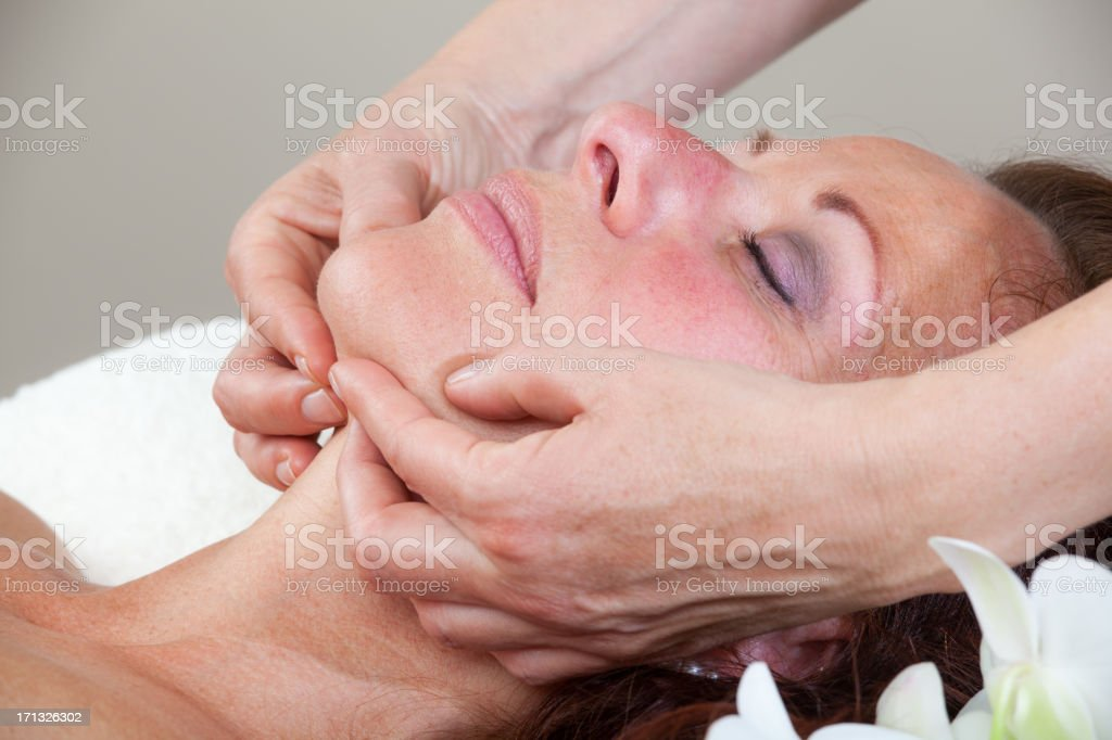 Mature Woman having relaxing massage royalty-free stock photo
