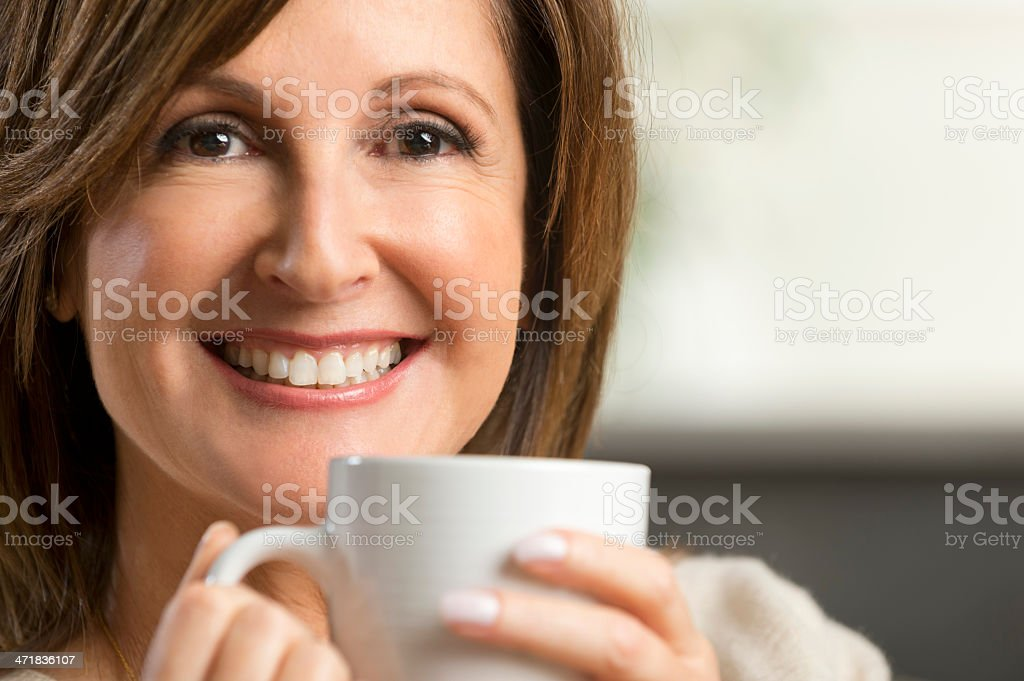 Mature woman holding a coffee cup royalty-free stock photo