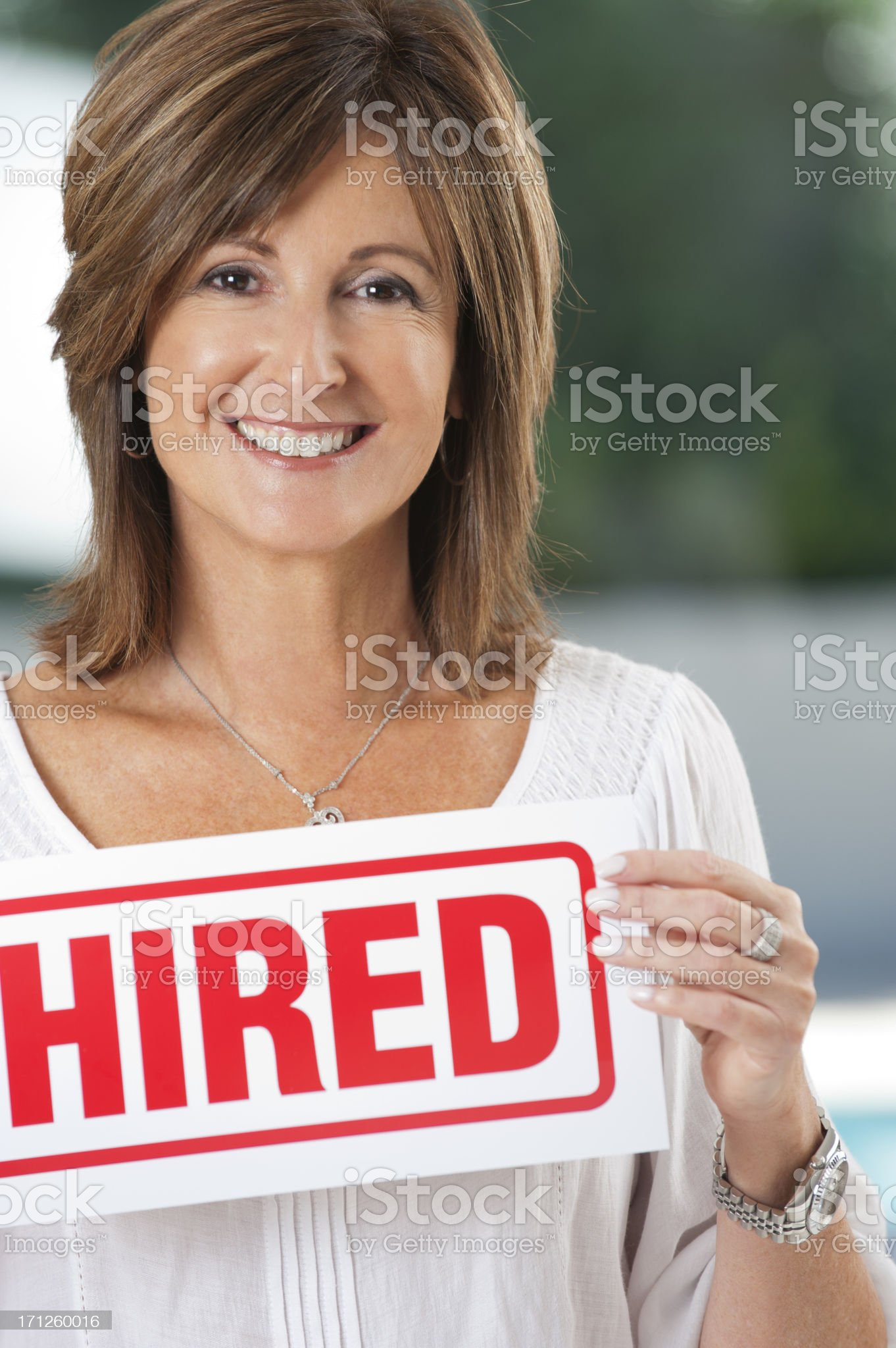 Mature woman holding a hired sign royalty-free stock photo