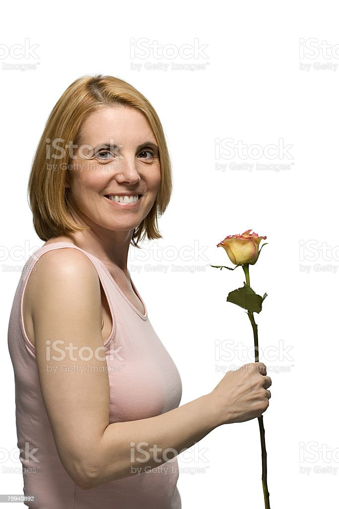 Mature woman holding a rose royalty-free stock photo