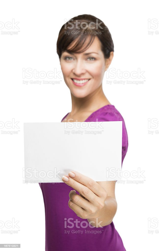 Mature woman holding blank card royalty-free stock photo