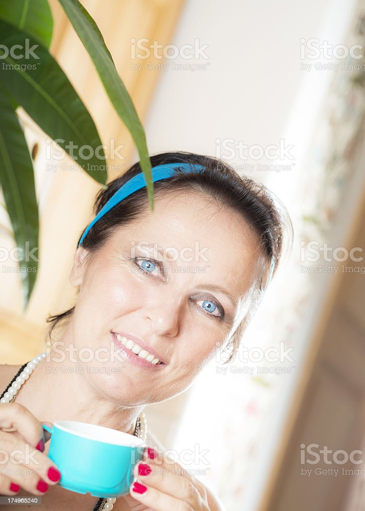 Mature Woman Holding Blue Cup of Coffee(Tea) royalty-free stock photo