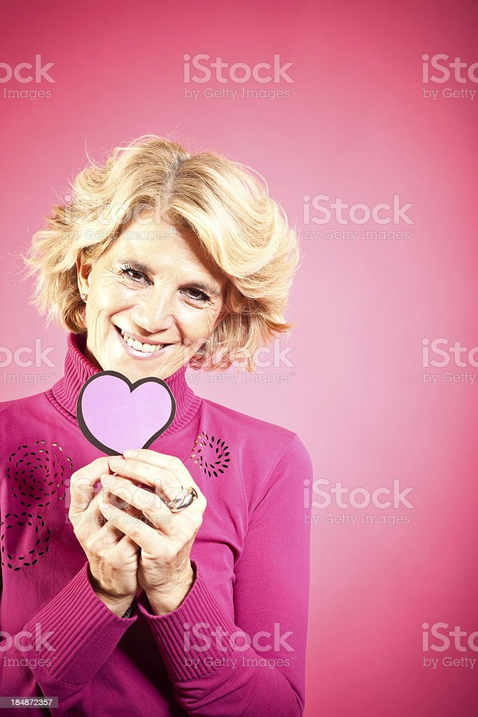 Mature Woman Holding Heart royalty-free stock photo