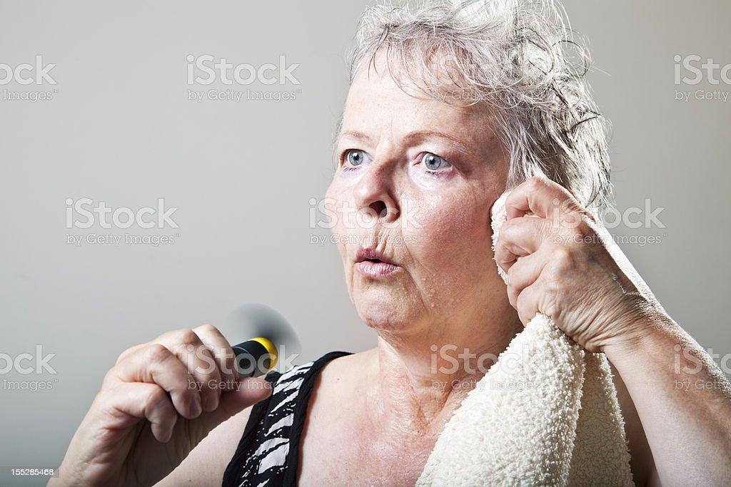 mature woman hot flash menopause portrait stock photo