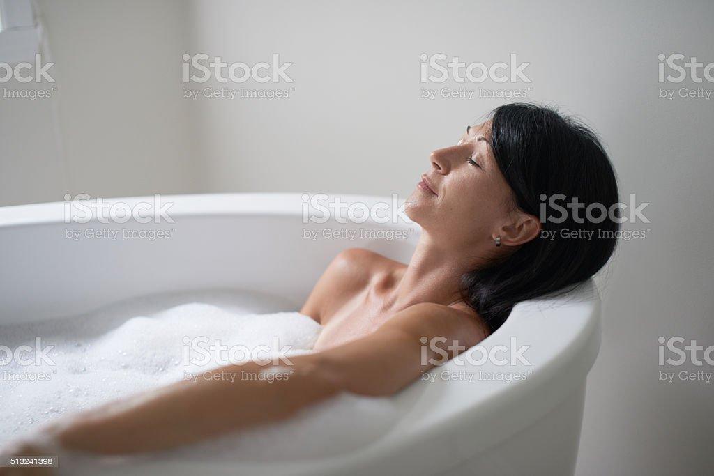 mature woman in a bathtub stock photo
