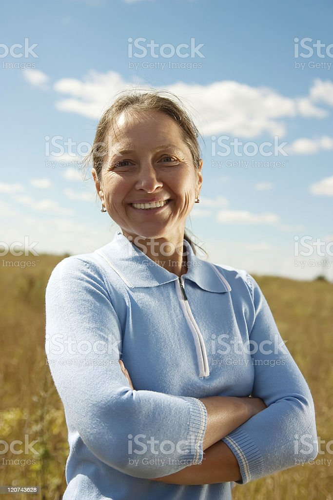 Mature woman in blue royalty-free stock photo