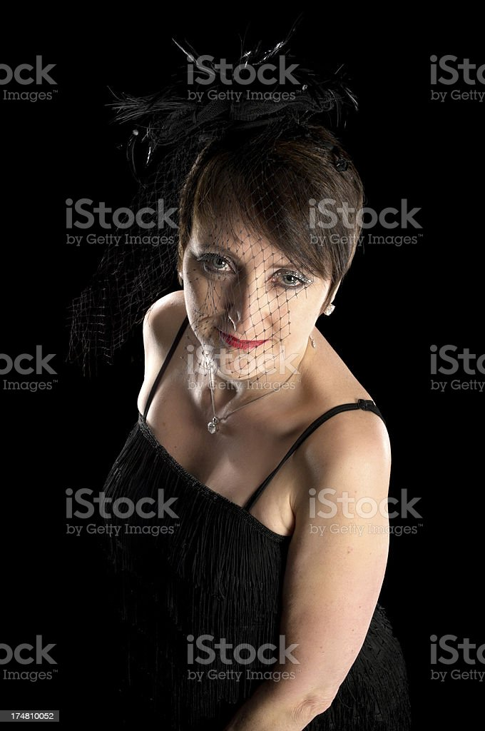 Mature woman in flapper dress and veil. royalty-free stock photo