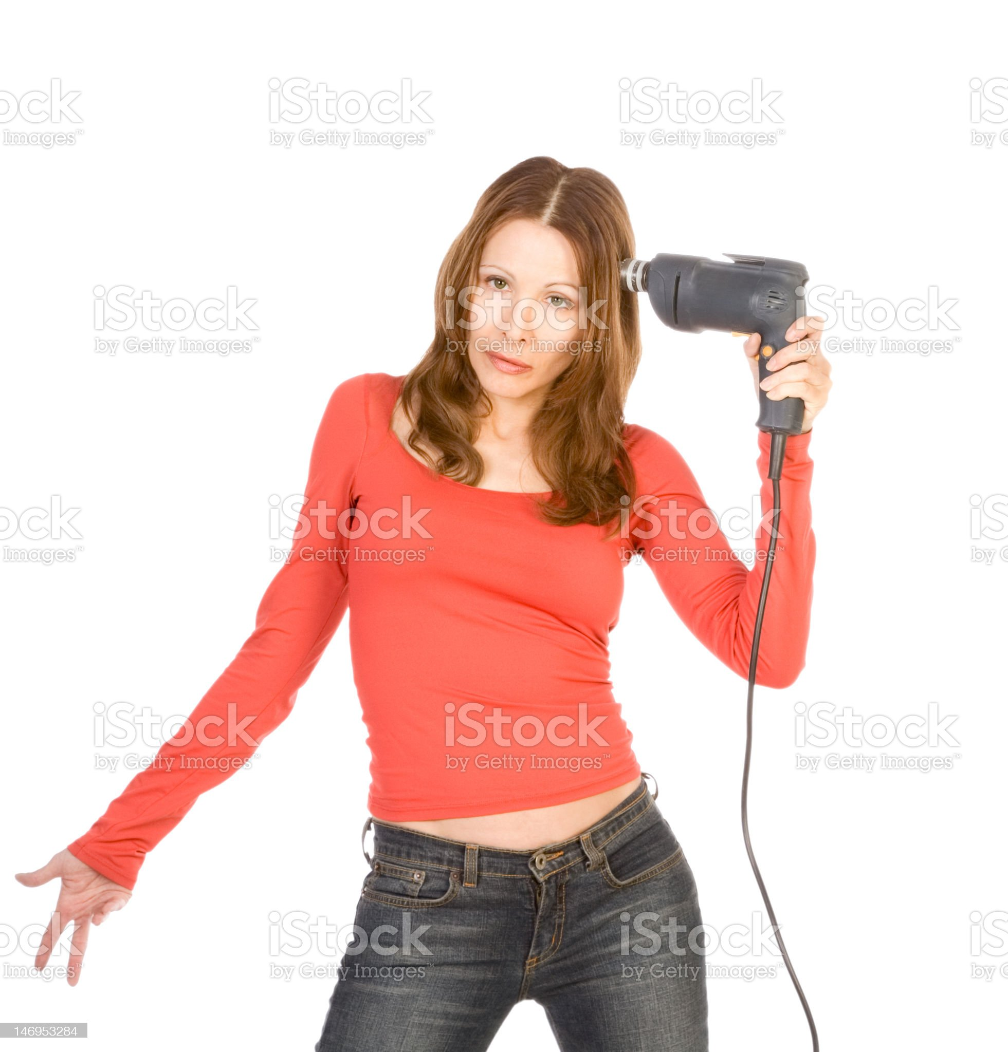 Mature woman in frustration with drill by her temple royalty-free stock photo