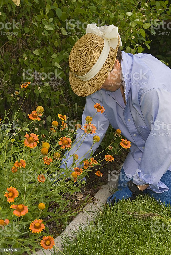 Mature Woman in her Garden royalty-free stock photo