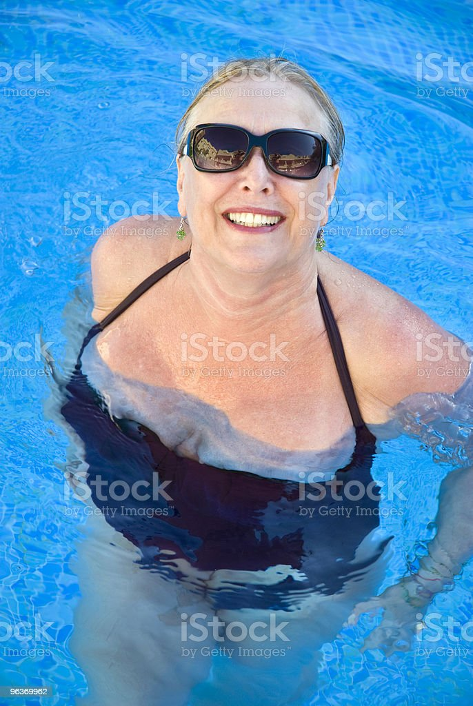 mature woman in pool royalty-free stock photo