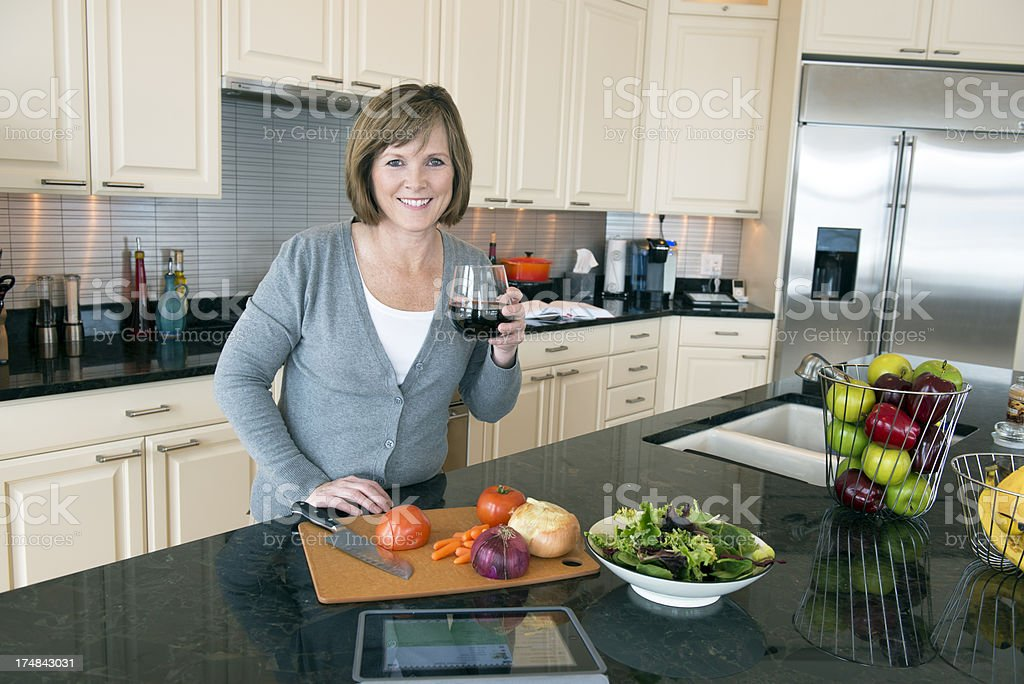 Mature Woman in the Kitchen stock photo