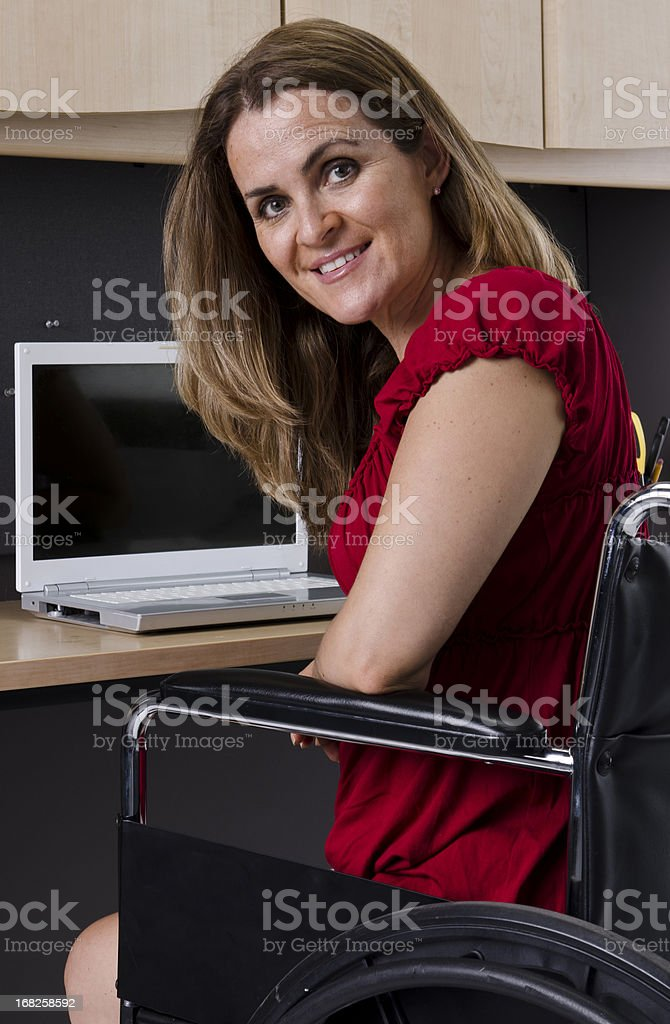 Mature woman in wheelchair royalty-free stock photo