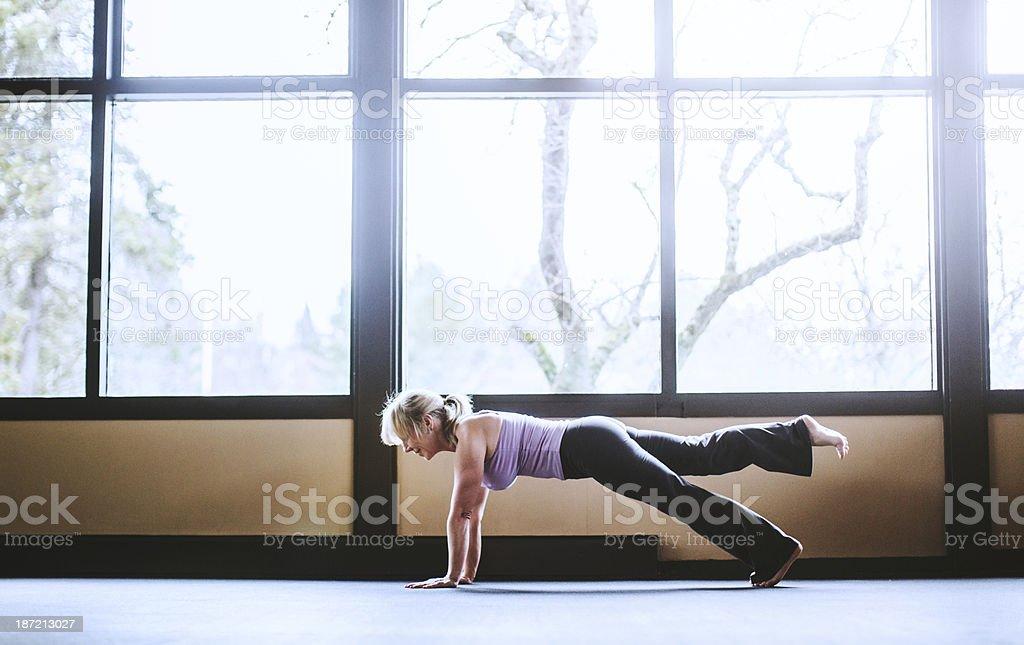 Mature Woman in Yoga Studio stock photo