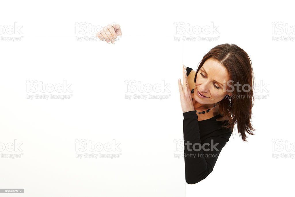Mature woman isolated on white background looking at board royalty-free stock photo