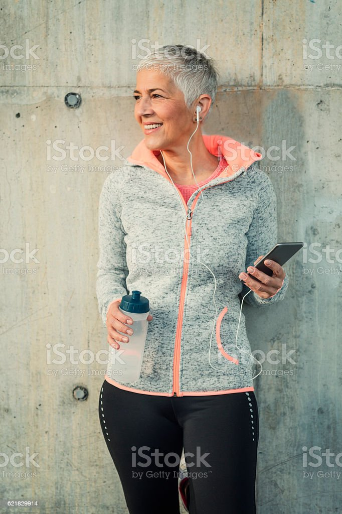 Mature Woman Jogging In The City stock photo