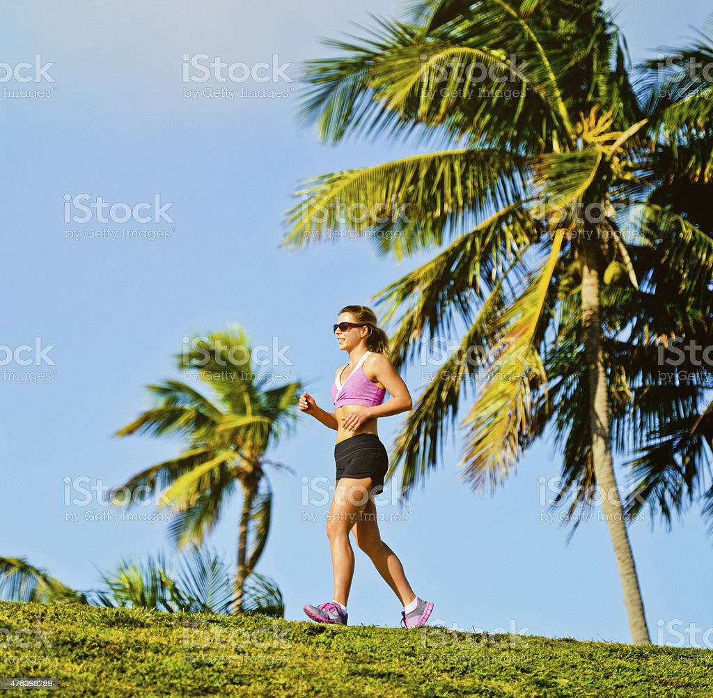 Mature Woman Jogging Outdoors royalty-free stock photo