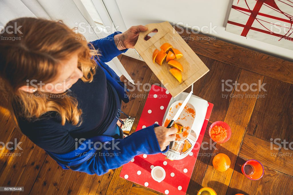 Mature woman juicing after fitness training stock photo