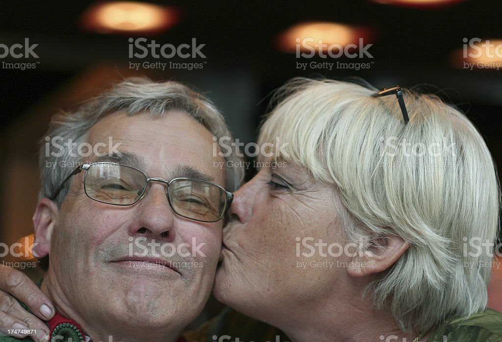 Mature Woman kisses her Husband royalty-free stock photo