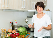 mature woman kitchen soup
