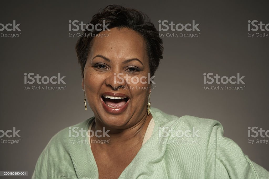 Mature woman laughing, portrait stock photo