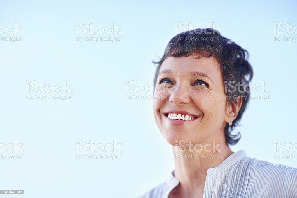 Mature woman looking at something stock photo