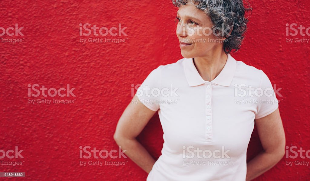 Mature woman looking away at copy space stock photo