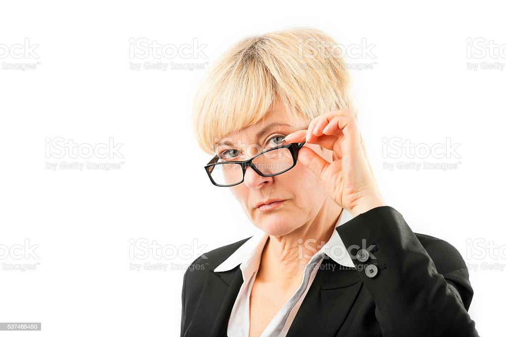 Mature woman looking through her glasses stock photo