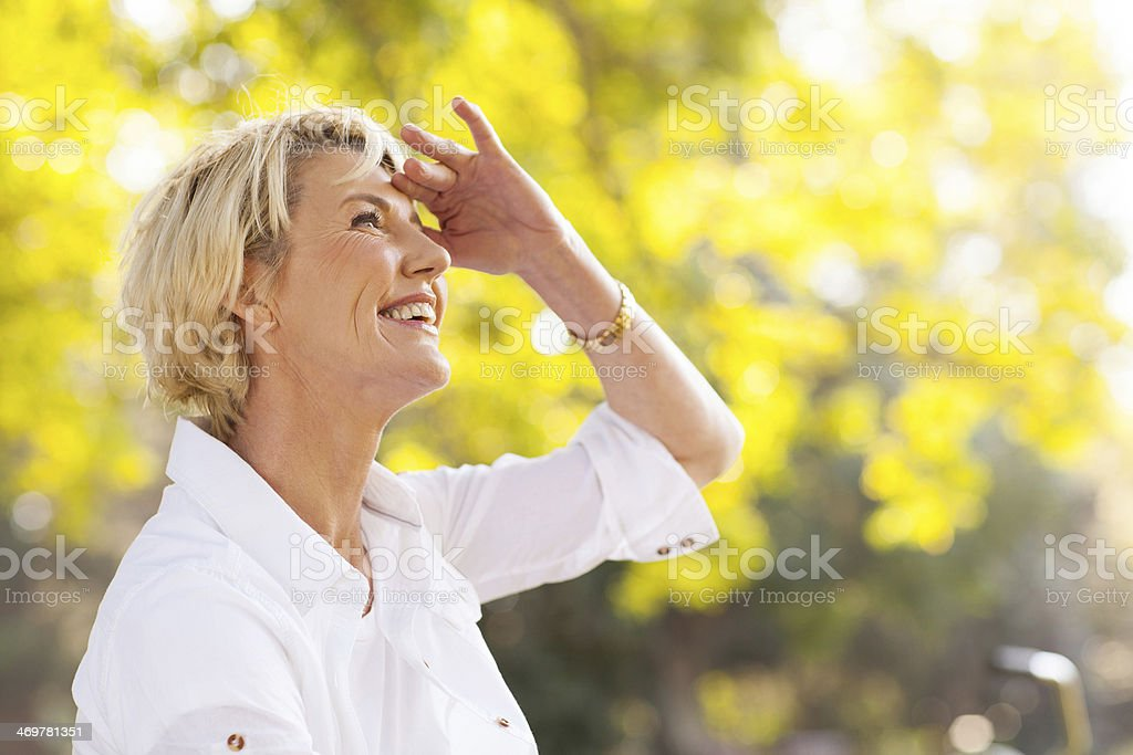mature woman looking up stock photo