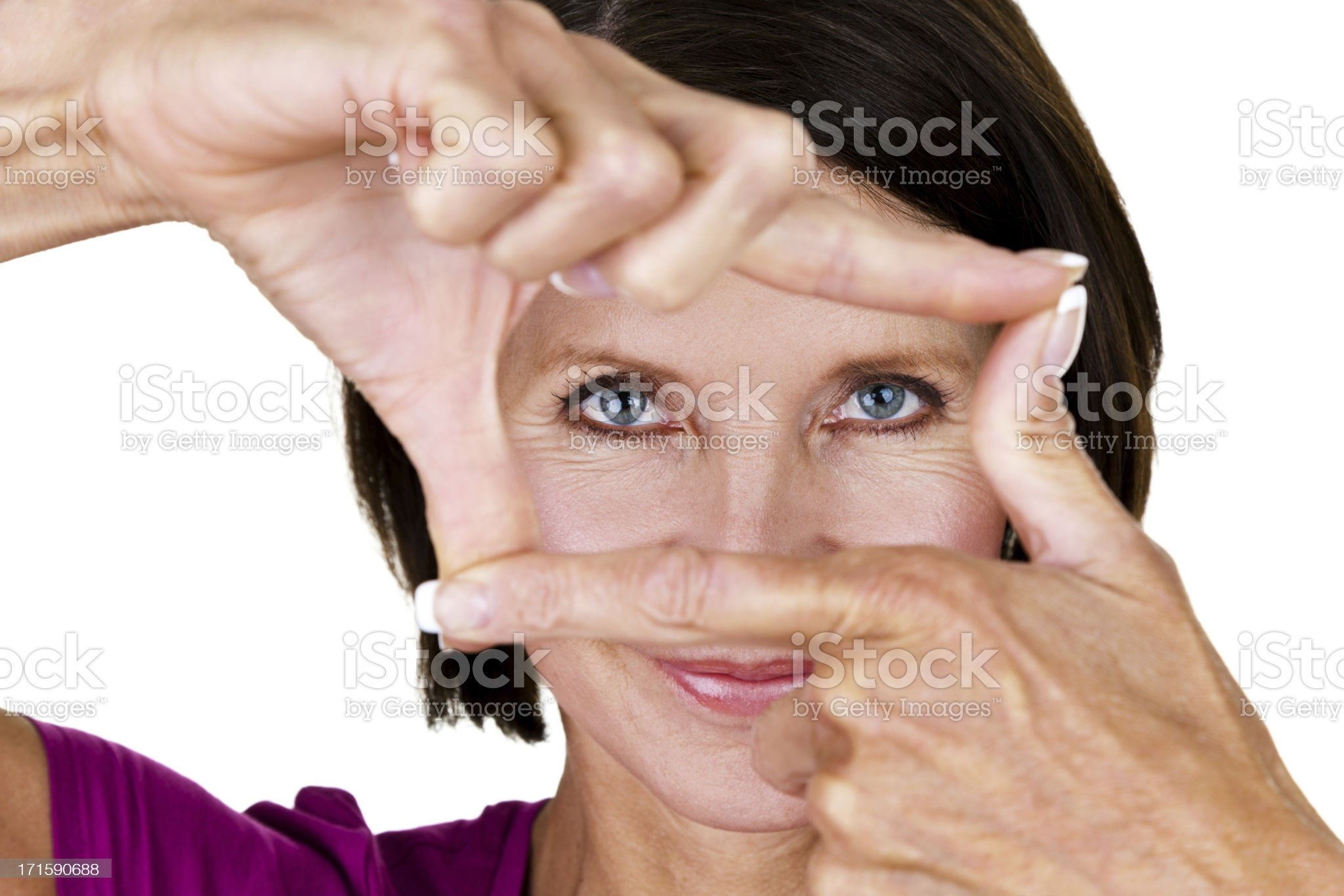 Mature woman making a finger frame royalty-free stock photo